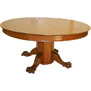 19th Century 60 Inch Round Oak Dining Table  with 6 Leaves