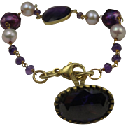 Stunning amethyst and cultured pearl bracelet with large charm