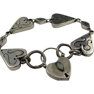 Gorgeous vintage carved Albert bracelet in 925 silver with large padlock set with natural opal