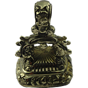 An unusually intricate pinchbeck  fob seal charm pendant set with rich red cornelien