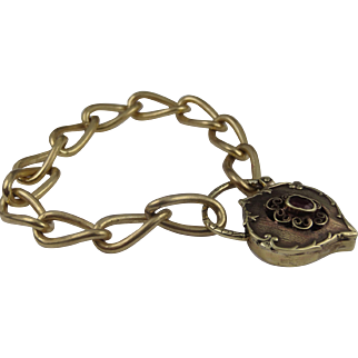 Gorgeous charm bracelet with ornate garnet padlock