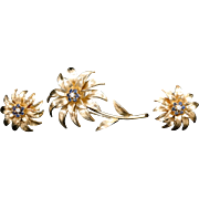 Tiffany & Co. 18K Yellow Gold with Diamonds and Sapphire Flower Brooch and matching earring set.