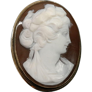 Victorian Era, Carved, Shell Cameo Brooch/Pendant Mounted in an 18 K Yellow Gold Bezel.