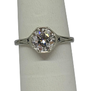 Antique European Cut Diamond Ring in 18K White Gold accented with Sapphires.