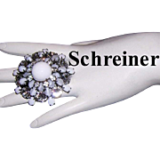 SCHREINER Shimmering Rhinestones Moonstone / Art Glass & Milk Glass Japanned Tiered Pin / Brooch