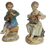 Meissen Figures of Boy and Girl Seated on Baskets of Flowers