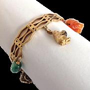 Six Charm Gold Link Bracelet 14k