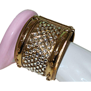 An Amazing Gold Tone Clamper Bracelet with Lucite Pools of Light
