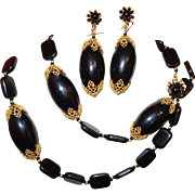 """Signed Miriam Haskell Black Glass Necklace and Earrings With """"Russian Gold"""" Filigree Caps"""