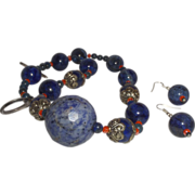 Hand Strung Creation of Lapis, Coral and Silver Tone Metal