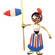 Miniature 'Puffed' Woman Holding a Flag Pin