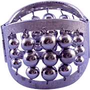 Textured Silvertone Wide Clamper Bracelet with Abacus-Style Bead Motif