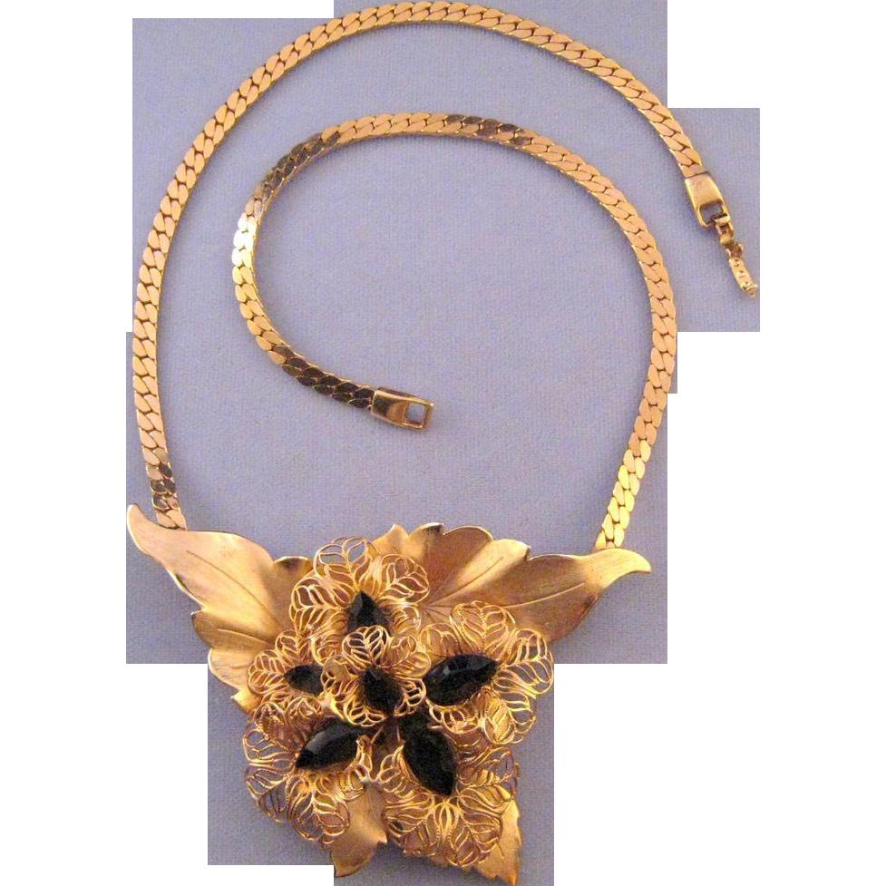 Goldtone Filigree Flower and Leaf Motif Necklace with Black Navettes