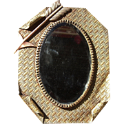 Ornate Victorian Beveled Mirror Mounted on Brass
