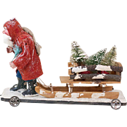 Antique German Trudging Santa Claus with Wooden Sled on Wheeled Platform