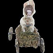 "Rare 1910s Antique German Bisque Face Easter Bunner Riding a Grass Car 5 1/2"""