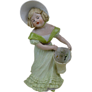 1910's Large Heuback Porcelain Figure of Girl in Green Dress with Basket 9.75""