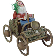 Early German Christmas Santa with Sprig in a Wooden Car