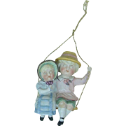 Adorable Porcelain German Children Swingers Decoration