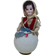 Early 1900's Christmas Girl Rolling a Snowball Candy Container