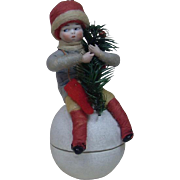 Large Sized Heubach Christmas Child Sitting on a Snowball Candy Container