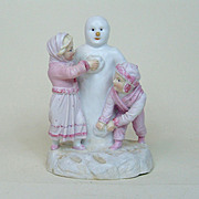 Very Rare German Christmas Porcelain Bisque Children Making a Snowman Figurine