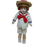 German Bisque Laughing Heubach Doll with Sailor Outfit 15""