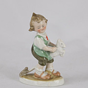 1910s German Goebel Little Boy Riding a Stick Horse Porcelain Bisque Figurine