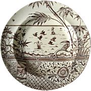 Melbourne soup plate :Aesthetic Movement southseas theme, bamboo ,sampan, flowers ,water