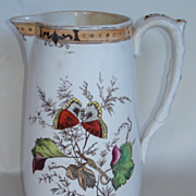 Pitcher with Butterflies,grapevine,sprays of grains.