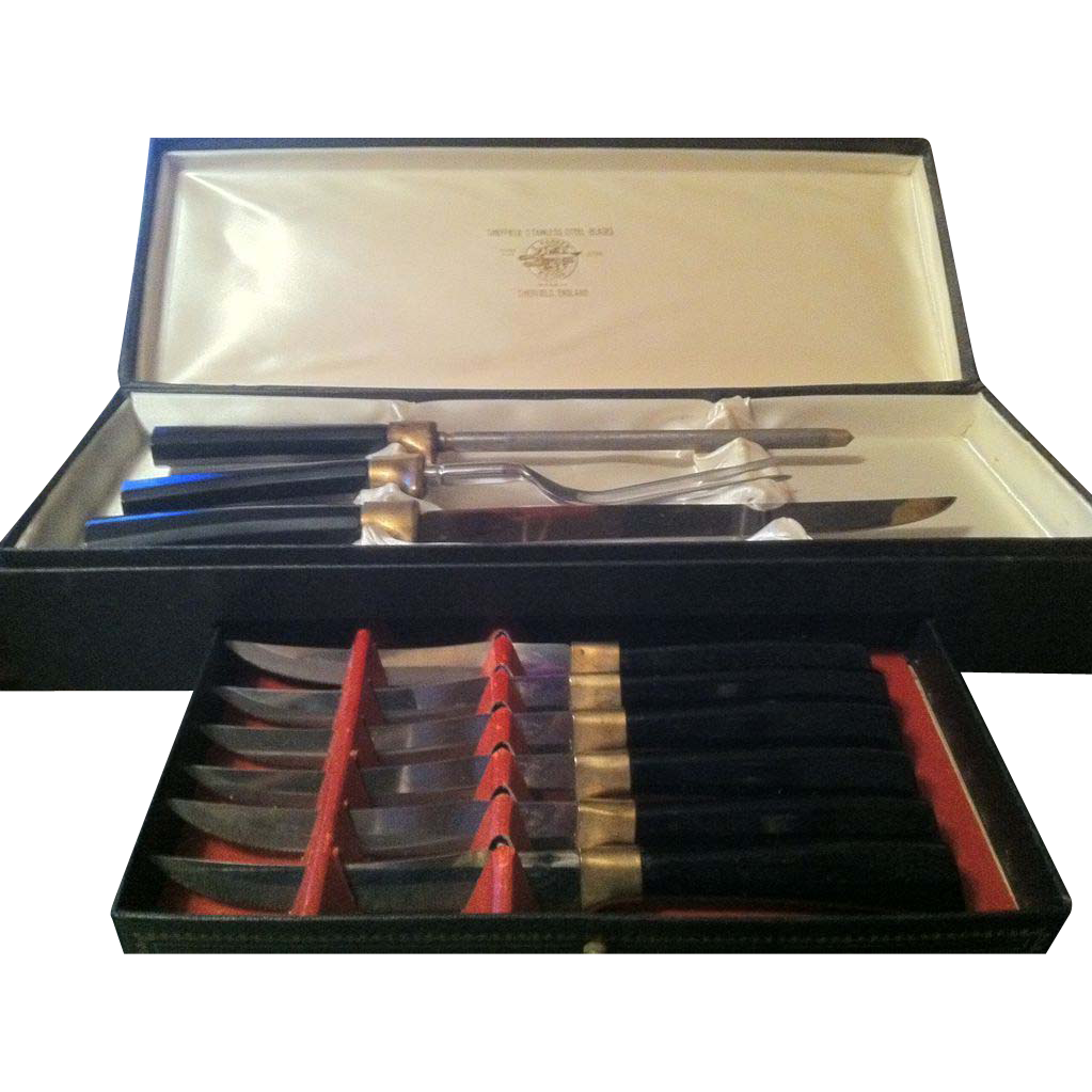 Carving set with six steak knives in original box from