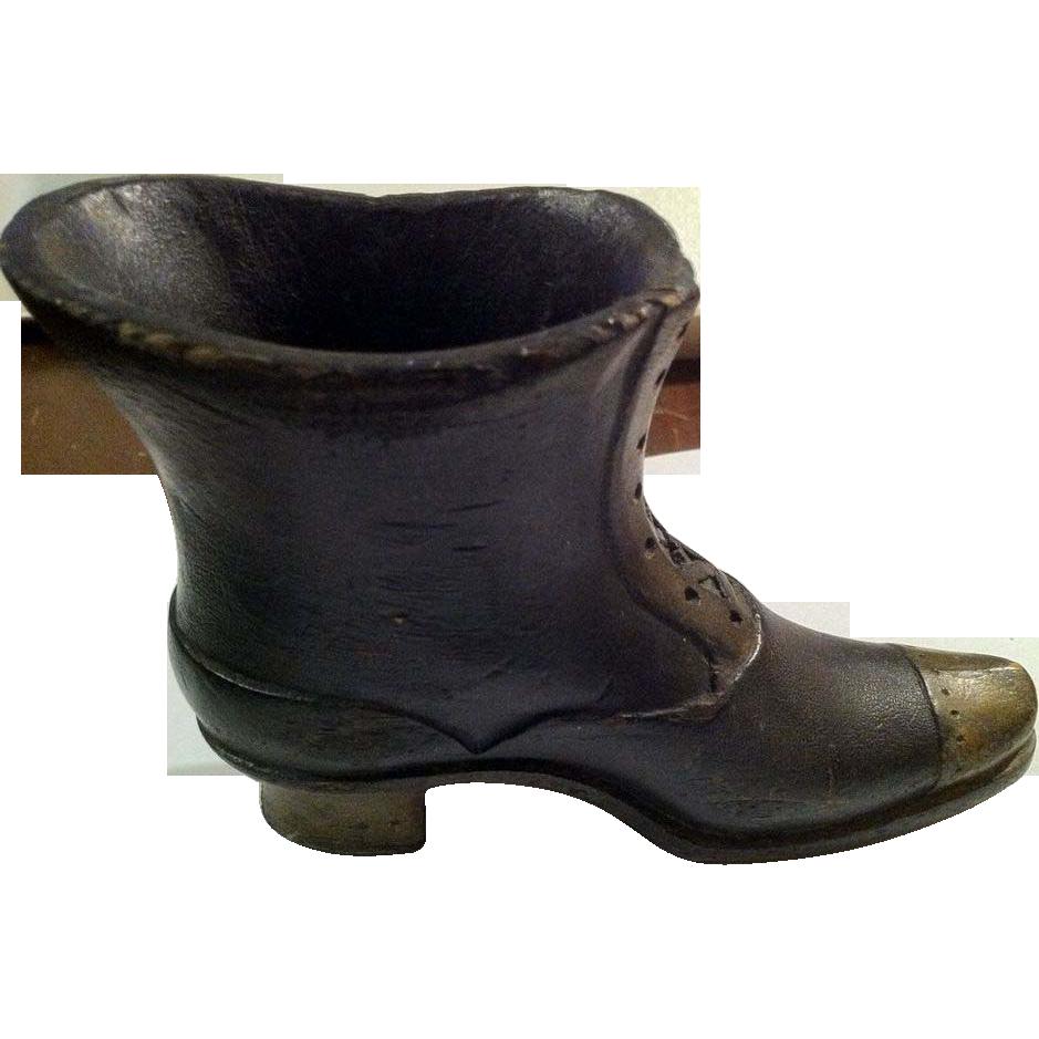 carved shoe boot holder vase from