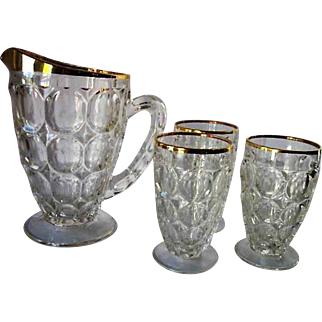Jeanette Glass Thumbprint Gold Trim Pitcher and Three Juice Glasses