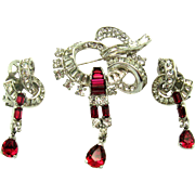 MAZER Set Bow Brooch and Earrings Ruby Red and Clear Stones in Silver Rhodium