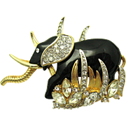 HATTIE CARNEGIE Lucite and Rhinestone Elephant in the Grass Brooch