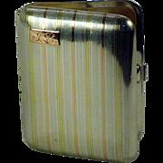 An American Art Deco 14K and sterling silver cigarette case, circa 1925