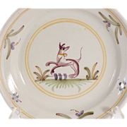 A late 18th century French faience plate, probably Quimper, circa 1790