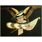 A 19th century American Folk Art eagle holding flags and a shield, all done in Feather work, circa 1876.