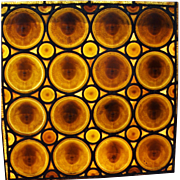 A set of Tiffany Studios amber glass cherub head windows, New York City, circa 1895.