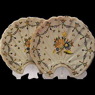 A pair of mid 18th century Talavera majolica scalloped shaped barber's bowls, Talavera de la Reina, Castile, circa 1765