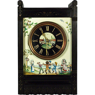 A late 19th century Kate Greenaway American Aesthetic mantle clock, retailed by Hall, Nicoll & Granbery, New York, circa 1885.
