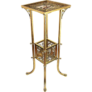 A superb American Aesthetic brass table with an inset polychrome tile top, probably Bradley and Hubbard, Meriden, Connecticut, circa 1883.