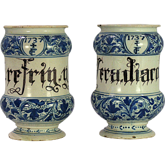 A rare pair of early 18th century North Italian majolica drug jars/albarelli, probably Savona, dated 1737