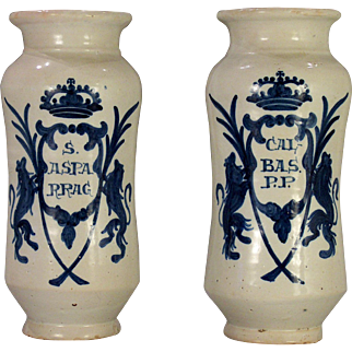 A pair of large mid-17th century Talavera armorial drug jars/albarelli, Talavera de-la-Reina, Spain, circa 1650