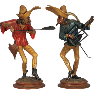 A pair of vintage mid-century candelabra depicting two dancing Commedia del'arte chefs, probably Italian circa 1960