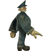 An early 20th century American Folk Art carved wooden figure of a traffic cop, circa 1925