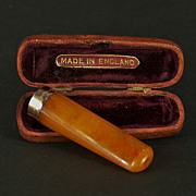 A fine Victorian 9 carat gold banded amber cigarette/cheroot holder with its original leather carrying case, Birmingham, England, 1863