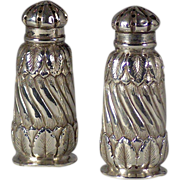 A fine pair of American sterling silver luncheon pepper shakers in the organic Aesthetic taste, Peter L. Krider Co. Philadelphia, Pennsylvania, circa 1885.