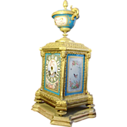 Original French gilded bronze figural and porcelain hand painted mantel clock, circa 1880 , signed
