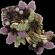 Vintage Stanley Hagler Purple Rhinestone Seed Beads Stylized Bouquet Brooch